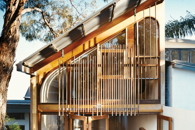 Façade with custom cedar windows and wooden dowels