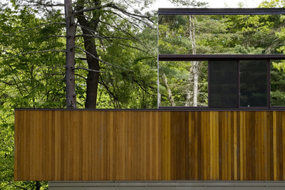 Modern two-story home with mirrored siding and plate-glass windows