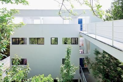 modern footbridge in the richard meier designed douglas house
