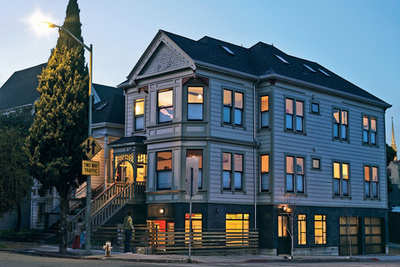 the purple clapboard exterior of a Victorian home in San Francisco