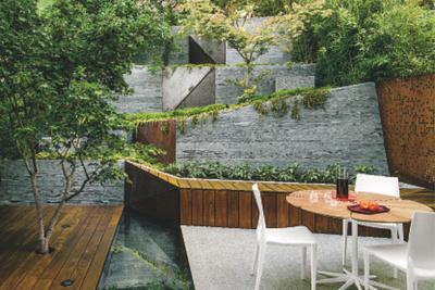 a maple tree grows through an pie deck on a white granite patio