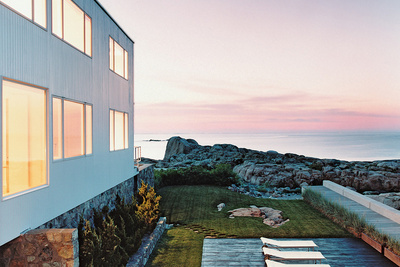 a sunset shot of the exterior of a seaside house in Massachusetts