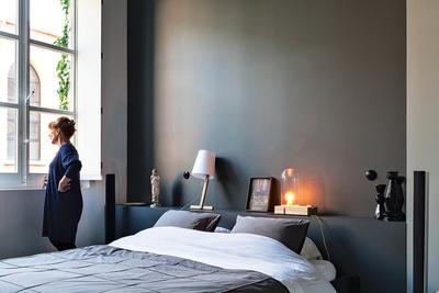 a dark gray bedroom