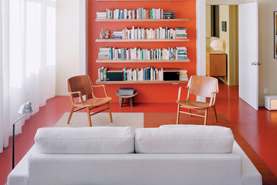 the orange inset wall and shelving in a Boston apartment