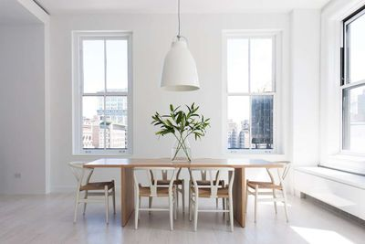 Manhattan loft apartment near Union Square by Resolution 4 Architecture with Hans Wegner chairs and wood dining table.