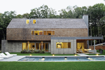 Hamptons house with a pool and cedar siding