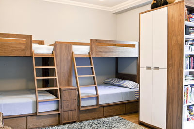 custom bunk beds made from walnut wood