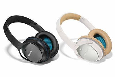 Black and white pairs of Bose QuietComfort 25 noise-cancelling headphones.