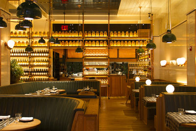 Roman and Williams New York City restaurant design for Upland with leather, wood, and copper interior