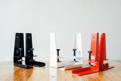 the floyd shelf in red, white, and black versions