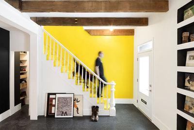 montreal rowhouse renovaton entryway stairs yellow