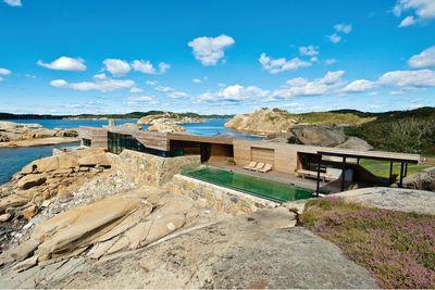 summer house norway cliffside terrain