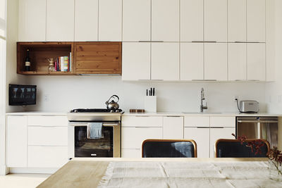 All-white kitchen in a historic Brooklyn town house