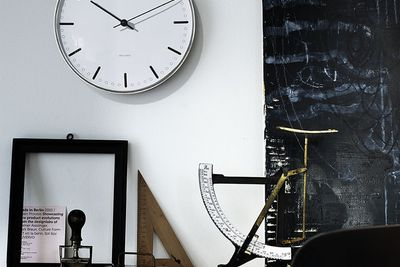 Classic wall clock with sleek frame and hands