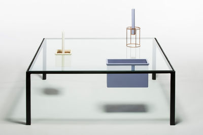 Rectangular bento glass table with compartments.