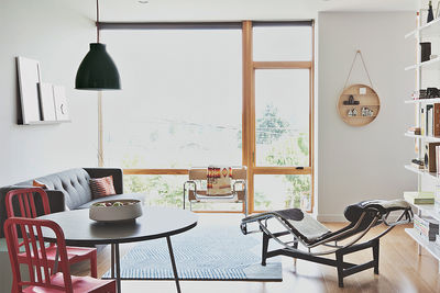 capitol gains seattle multifamily living dining room wassily chair chaise le corbusier cb2