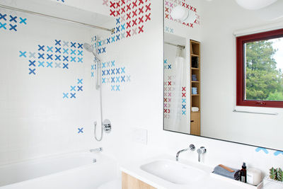 collective cleanse vancouver bathrooms dear human x shaped decals tiles kids bathroom bette tub duravit sink corian countertop