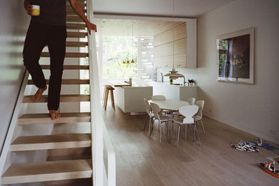 come together brooklyn family town house renovation white oak staircase flooring dining area anre jacobsen chairs louis poulsen pendant