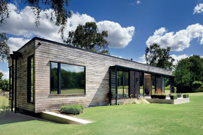 forest for the trees english prefab mobile home facade chesnut cladding