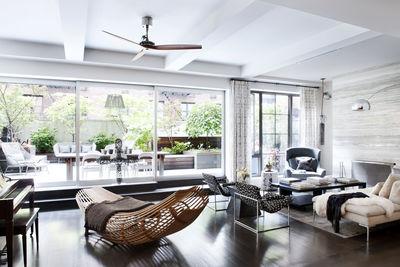intage Milo Baughman chairs, Darren Vigilant side table and B&B Italia sofa define the living room.