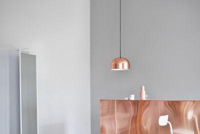 Copper pendant light in neutral space
