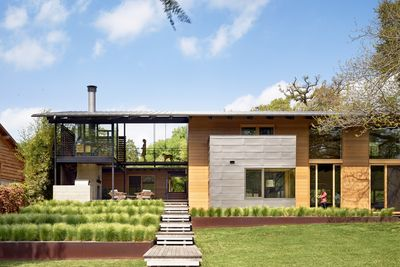 Covered porches lead into a Texas retreat