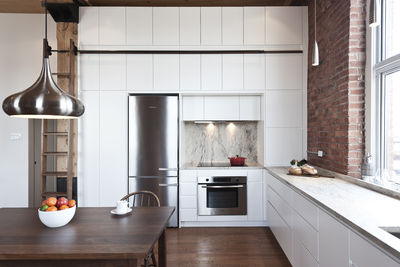 Kitchen of 850 square-foot Montreal apartment renovation by Gepetto.