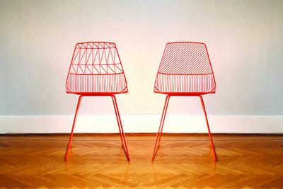 Powder-coated iron side chair in neon orange