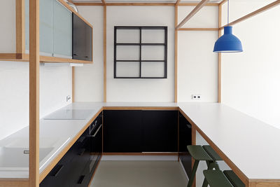 Hay Copenhague Bar Stool and Muuto Unfold light in kitchen of Prague guest apartment by Mjölk and DDAANN.
