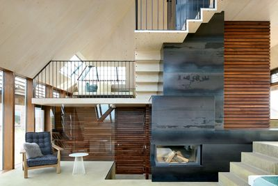 Fireplace and stairs in the Netherlands dune house