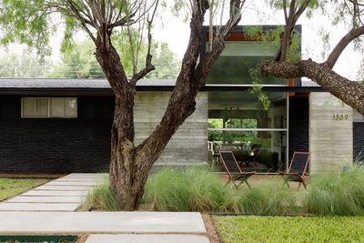 new territory texas family renovation facade concrete beams window