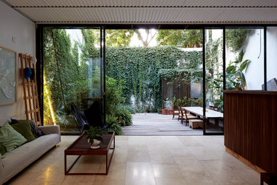on a clear day buenos aires argentina family home living area sliding doors corrugated metal ceiling