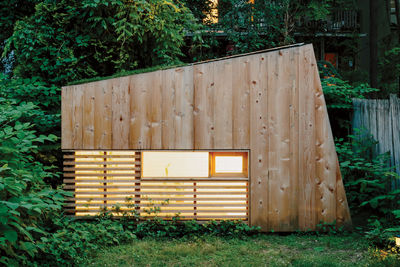 Modern Brooklyn backyard studio with plexiglass skylight, green roof, and cedar cladding facade