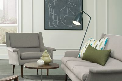 Sophisticated midcentury couch and lounge chair