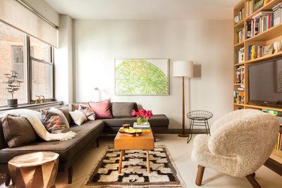 the great divide new york city small space studio dunbar sofa finn juhl pelican chair wire chair bddw coffee table