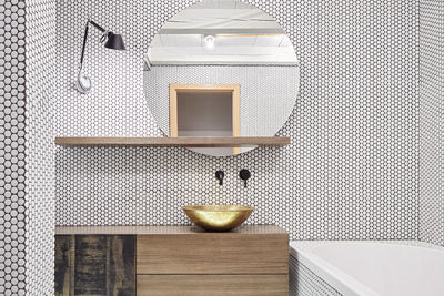 Tolomeo Micro Parete lamp from Artemide and brass washbasin from Morocco in Prague bathroom renovation.
