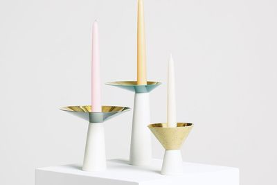 Three sculptural candle holders with mixed materials