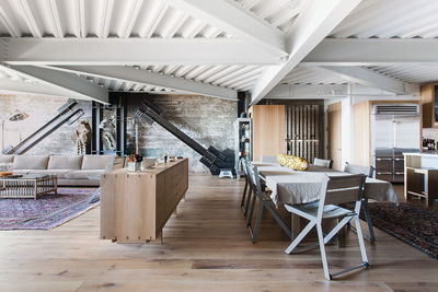 White oak floors, exposed concrete, and steel beams in renovation by Erica Severns.