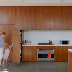 Monti catered to his mother's love of cooking by giving her ample storage areas along the 70-foot long walnut wall-slash-cabinet. The refrigerator, kitchen items and other goods easily disappear into the wall when not in use. The nonporous, stain-, scratc