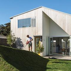 a matter of truss new zealand facade yard cedar cladding grassy berm portrait