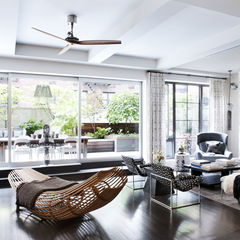 intage Milo Baughman chairs, Darren Vigilant side table and B&B Italia sofa define the living room.