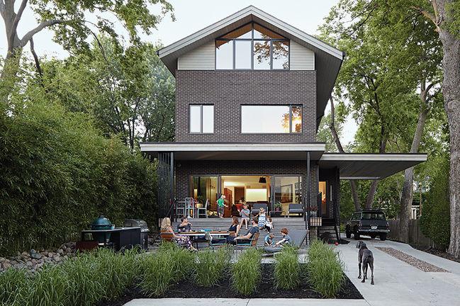 history lesson kansas city outdoor backyard facade porch saarinen round table emeco navy chairs