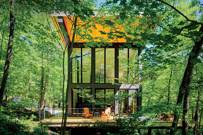 in the balance small space massachusetts cantilevered cabin glass facade