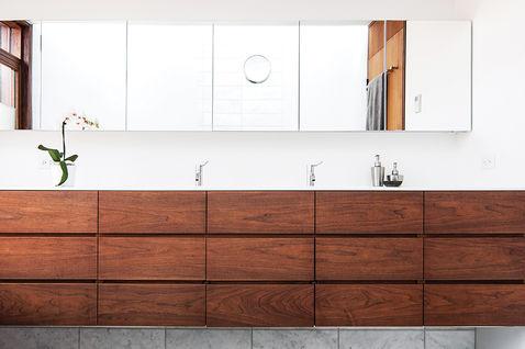 light and shadow bathroom walnut storage units corian counter vola faucet