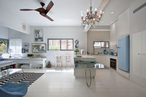 Tel Aviv kitchen with custom dining table and Smeg fridge