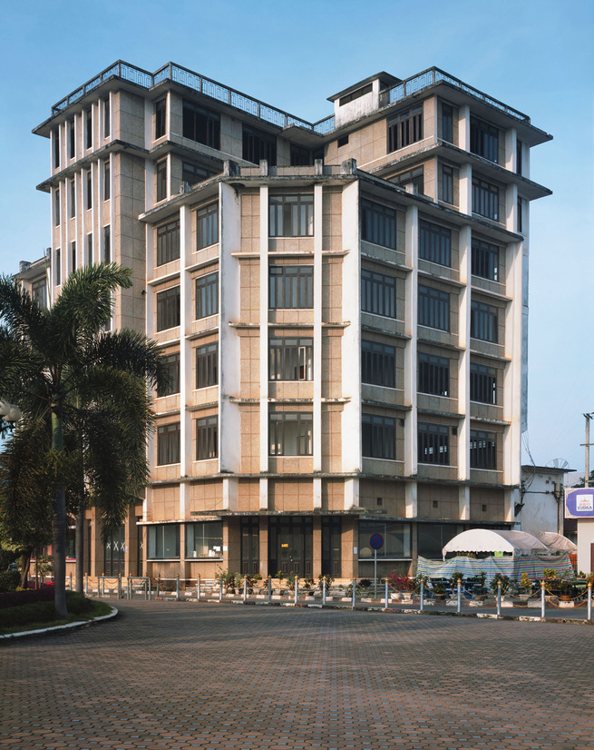 For a long time this building was the tallest building in Vientiane. I love the way it shoots straight up and out with those lines accentuating its verticality. That must have been quiet a terrace up on top in its heyday. It was probably built in the 1950