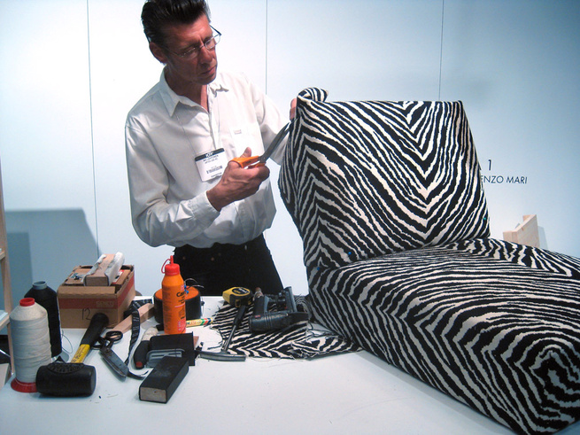 The hard part is cutting the fabric to fit properly says Artek upholsterer Aki Lehtonen.