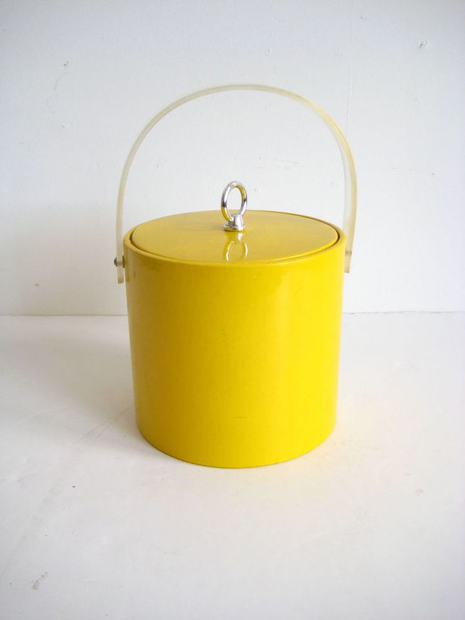 Among the many design finds at Back Garage, an online retailer of vintage pieces, is this yellow Georges Briard ice bucket.