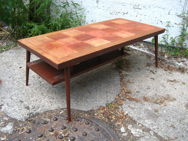 The original table. It looks like someone already stripped the top, but the bottom legs and suspended magazine rack are painted an ugly shade of reddish brown.