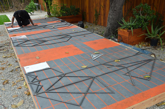 Once all the pieces are cut correctly and laid out on the grid, they are ready to be welded.
